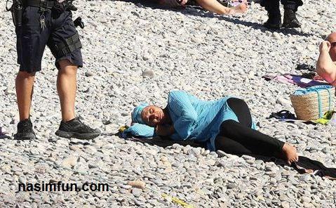 اجبار کردن زن مسلمان به درآوردن مایوی اسلامی اش در ساحل!!!+ عکس