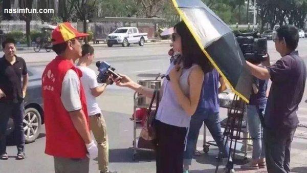 تعلیق خبرنگار زن به علت استفاده از چتر و عینک آفتابی!!!+عکس